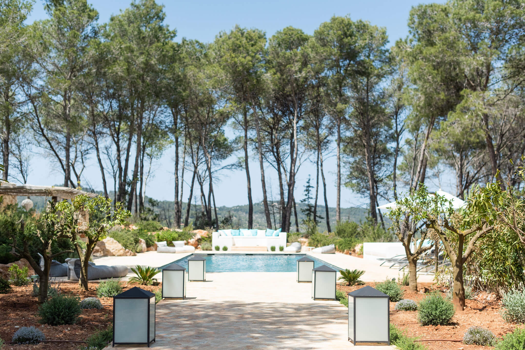 https://dev.white-ibiza.com/wp-content/uploads/2020/05/white-ibiza-villas-can-terra-surrounded-by-forest.jpg